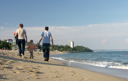 Family stroll along seashore